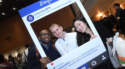 Students posing with in Instagram frame at an SPS event